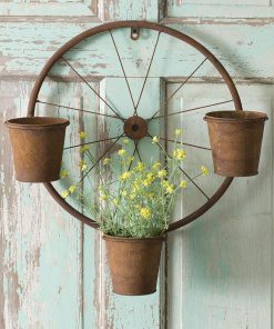annistyn rusty bicycle wheel wall planter