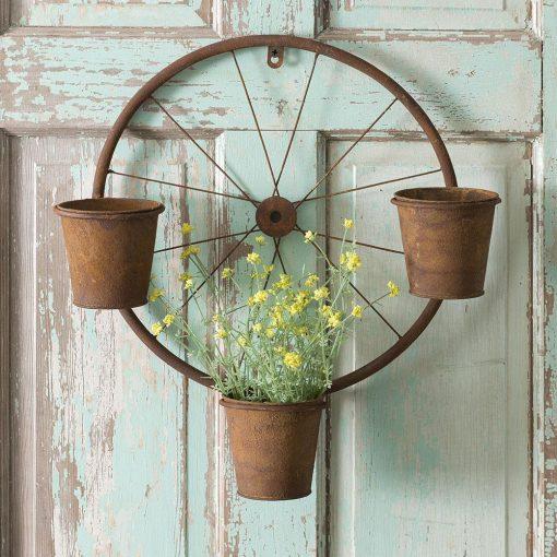 annistyn rusty bicycle wheel wall planter