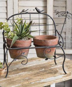 bonjour metal garden bench with terra cotta pots