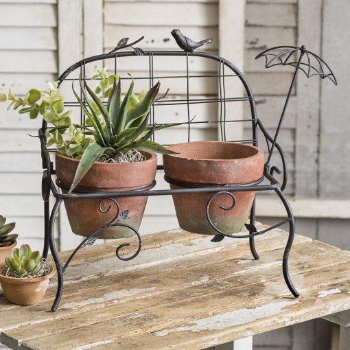bonjour metal garden bench with terra cotta pots