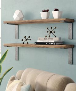 cleobella industrial accent wall floating shelves
