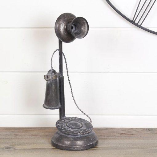 kelly distressing black metal telephone sculpture